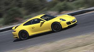 porsche racing wallpaper 2018 porsche 911 carrera gts coupe color racing yellow side