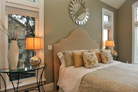 inspired starburst mirror in living room transitional with warm