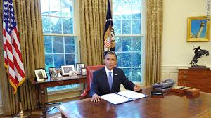 obama at desk obama signs short term spending bill into law cnn political ticker
