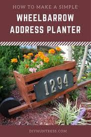 Wooden Wheelbarrow Planter by 10 Diy Wooden Wheelbarrow Planter Diy And Crafts Wheelbarrow