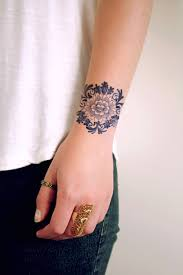 delfts blue round flower tattoo i like it because it looks like