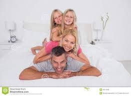 happy man giving a piggy back to his family royalty free stock