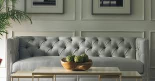 table gray sofa black coffee table white table lamps gray