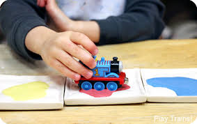 painting with trains ornament
