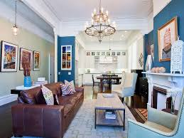 leather sofa mirrored coffee table paneling molding furniture full size of living room blue walls white wood decorative pillows fireplace surround great room