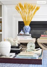 harvest haven fall tour 2016 citrineliving fall decorated living room featuring rich blue velvet and gold and blue and white accents