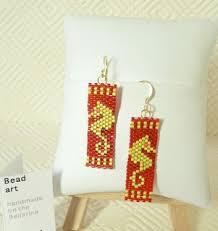 gaudy earrings daxdesigns bead earrings gender and a history