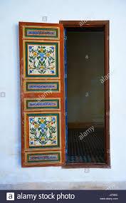 berber arabesque painted wood door and zellige tile floor the