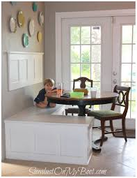 interior decorative wall combine with white banquette bench and