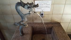 this sink in a japanese public bathroom is shaped like a dragon