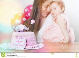 mother with cute baby celebrating first birthday cake stock