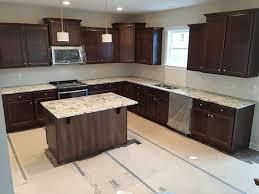 granite countertop yellow dark cabinets faucets for farmhouse