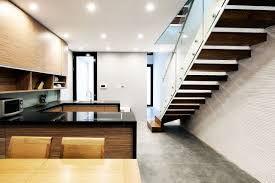 wooden staircase in stylish all white home interior inertiahome com