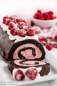an easy to make chocolate swiss roll with a raspberry filling