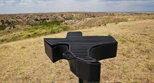 usa road trip texas barbecue trail a texas shaped barbeque grill with rugged texas scenery in the background