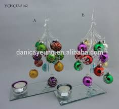 miniature glass christmas tree with colorful ornaments for xmas
