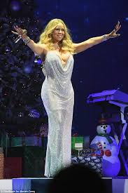 mariah carey sued by new york christmas carol singers daily mail