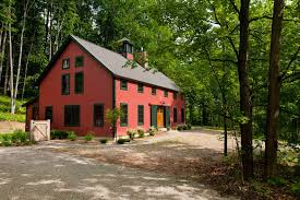 barn style post lights big front door exterior farmhouse with over size windows barn lights