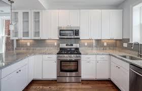 white kitchen cabinets grey backsplash ellajanegoeppinger com