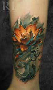indian religious om symbol with orange ink lotus flower tattoo