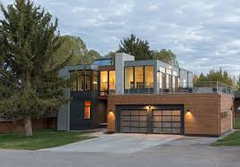 modern prefab homes ideas and what people need to know about the choose this modern prefab homes facade design with double garage doors and bright wall lamps