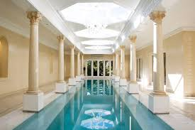 deluxe indoor pool decorating idea showing lap pool and classical