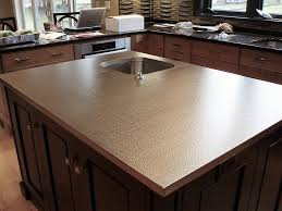 stainless steel kitchen island with machine hammered texture