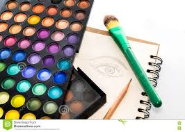 eye shadow color palette with brush and drawing eye on paper stock