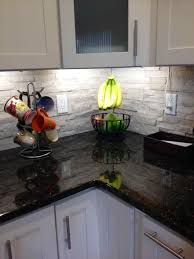 stone kitchen backsplash with white cabinets ideas pinterest