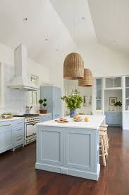 what paint color goes best with gray kitchen cabinets 7 paint colors we re loving for kitchen cabinets in 2021