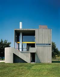 modern wood frame home clad in vertical cedar siding exteriors