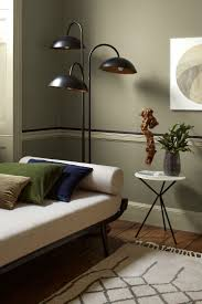 green livingroom bold living room with dark grey walls and