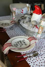 love this red and white christmas table with gnome centerpiece