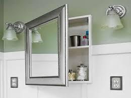 modern bathroom with corner shower stall and lighted medicine