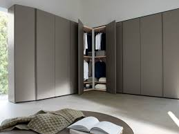 corner sectional wooden wardrobe design by molteni design team via