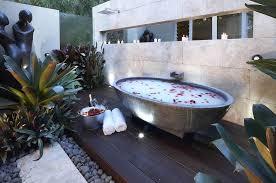 outdoor luxury bathroom blue bathtub white rug on wooden floor