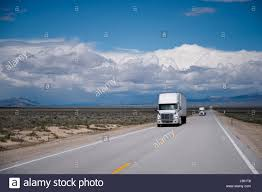 Nevada traveling images White semi trucks big rigs traveling on a commercial route for the jpg