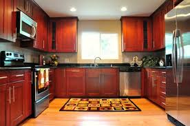 Red And Black Kitchen Cabinets by Cinnamon Cabinets Black Granite Countertops Shaker Cabinet Red