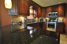 brown kitchen cabinets with backsplash black granite countertops styles tips infographic