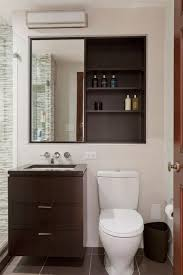 modern bathroom with recessed medicine cabinet installing