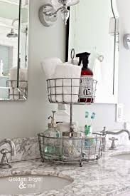 best 25 bathroom countertop storage ideas only on pinterest 2 tiered wire basket stand for bathroom organization www goldenboysandme com