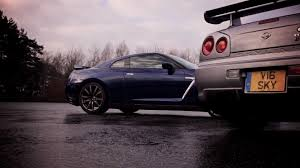 old nissan coupe nissan skyline gt r meets nissan r 35 gt r in old vs new clash