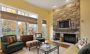 living room with fireplace and tv on different walls interior design