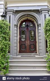 traditional grand front entrance door and portico painted white