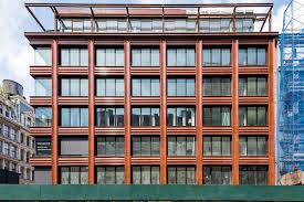 10 bond reveals its copper colored terra cotta facade curbed ny