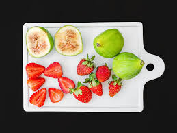 ceramic cutting boards a set of fresh fruit on a white ceramic cutting board stock image