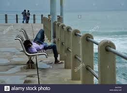 Bench Couple Shirt - scene of man with colourful purple shirt sleeping on bench while