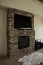 brick fireplace with tv above inspirations prettifying and making