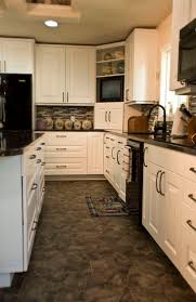 kitchens with white cabinets and black appliances what color tile flooring compliment cinnamon kitchen cabinets white