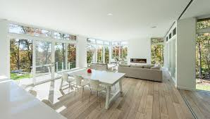 contemporary great room with hardwood floors by marvin windows and